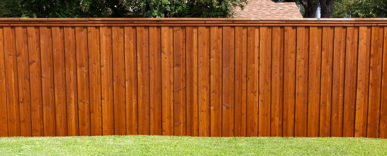 cedar privacy fence stained for protection against the sun